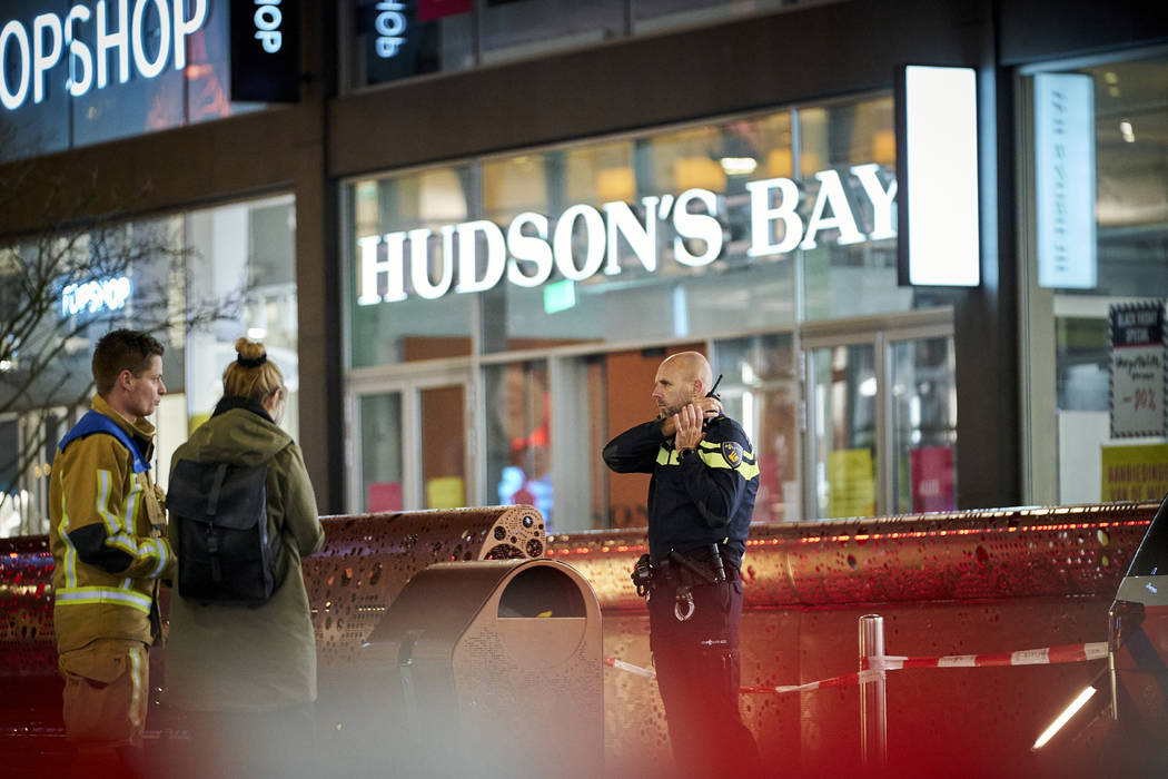 Dutch police block a shopping street after a stabbing incident in the center of The Hague, Neth ...