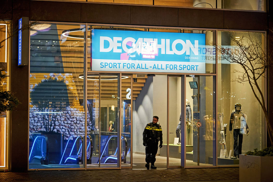 Dutch police secure a shopping street after a stabbing incident in the center of The Hague, Net ...
