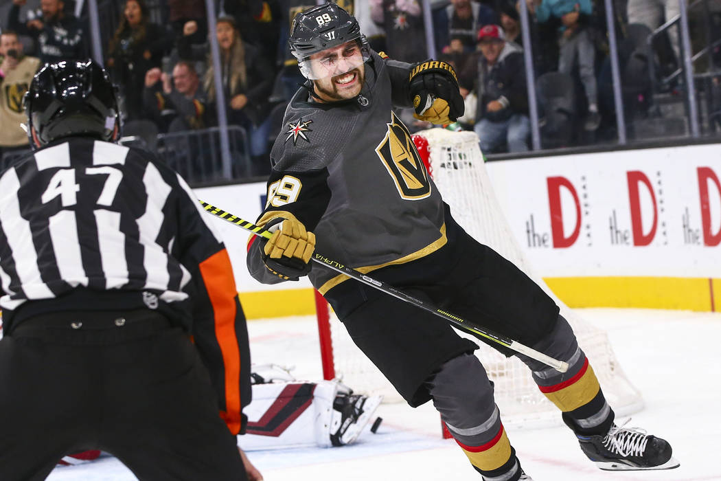 Golden Knights' Alex Tuch (89) celebrates after scoring in a shootout to win the game against t ...