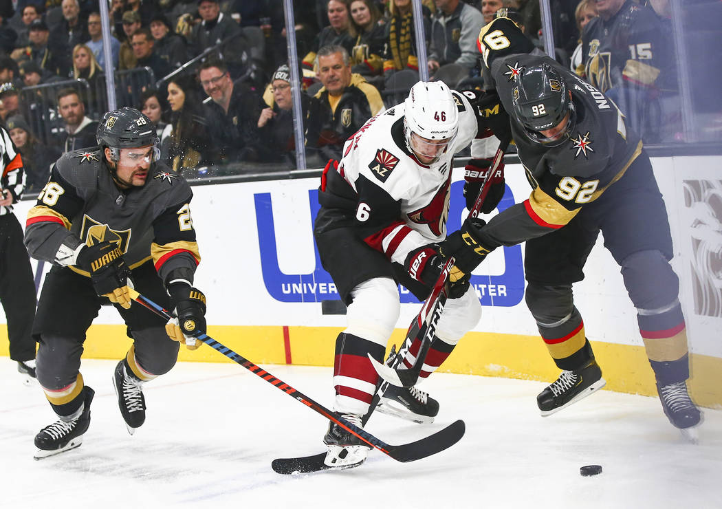 Golden Knights' Tomas Nosek (92) battles for the puck against Arizona Coyotes' Jakob Chychrun ( ...