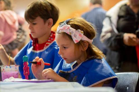 Harley Taylor, 5, of Las Vegas, paints a nutcracker ornament at Discovery Children's Museum's e ...