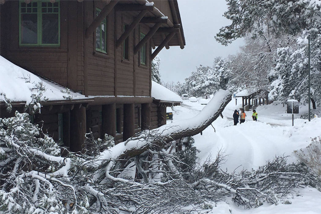 A snowstorm made life miserable for workers and visitors at the Grand Canyon Village on the Sou ...