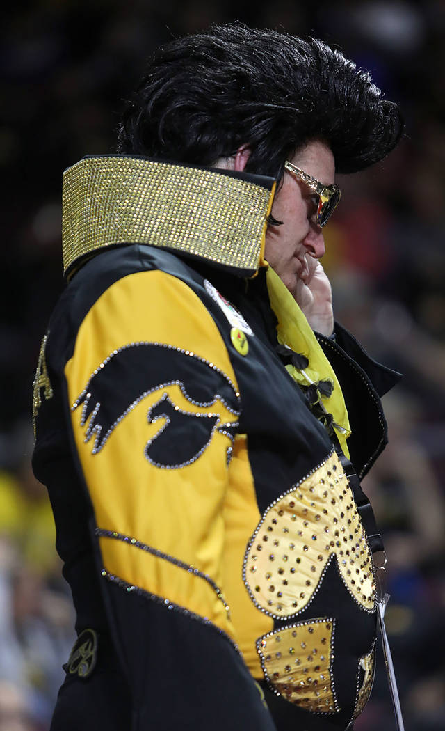 University of Iowa fan Greg Suckow wears an Elvis costume, as he does for every game, during th ...