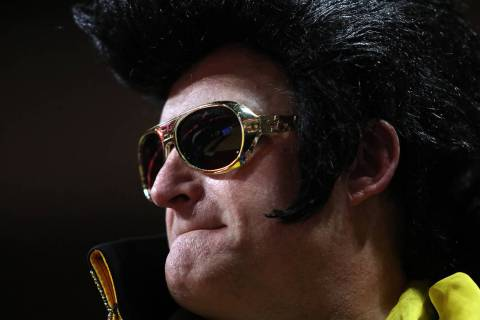 Greg Suckow of Eagan, Minnesota dresses as Elvis for the University of Iowa versus San Diego St ...