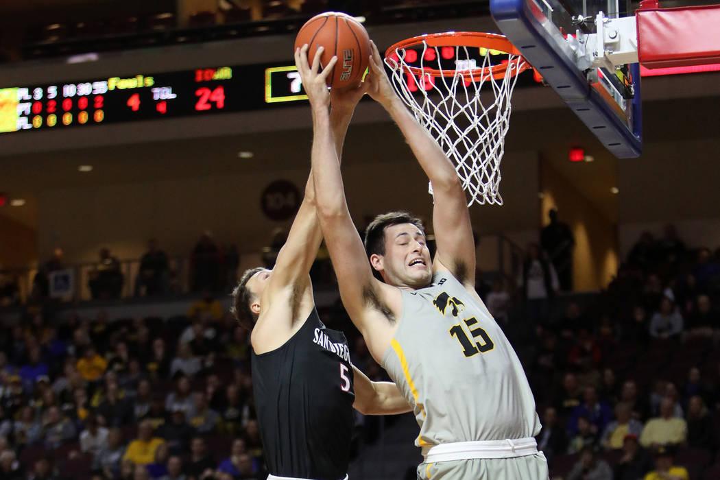University of Iowa's Ryan Kriener (15) dunks the ball as San Diego State University's forward Y ...