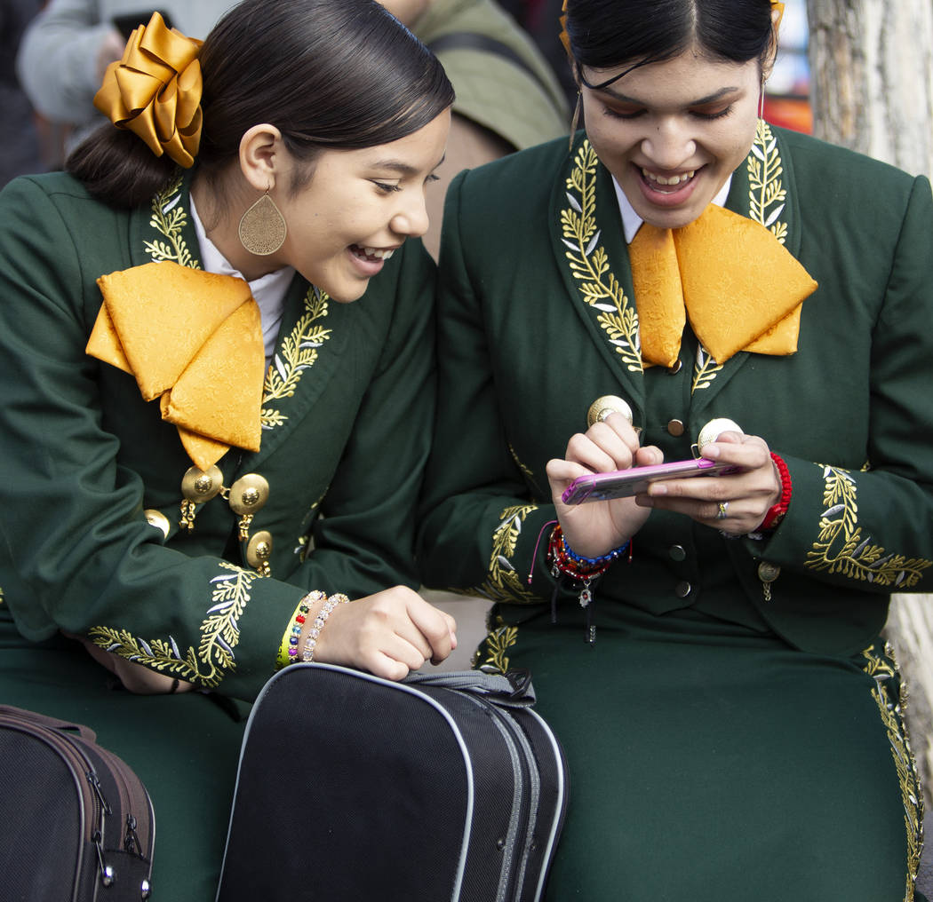 Mariachi bandmates Valeria Ibarra, 16, left, and Jasline Saltiear, 16, right, both students at ...