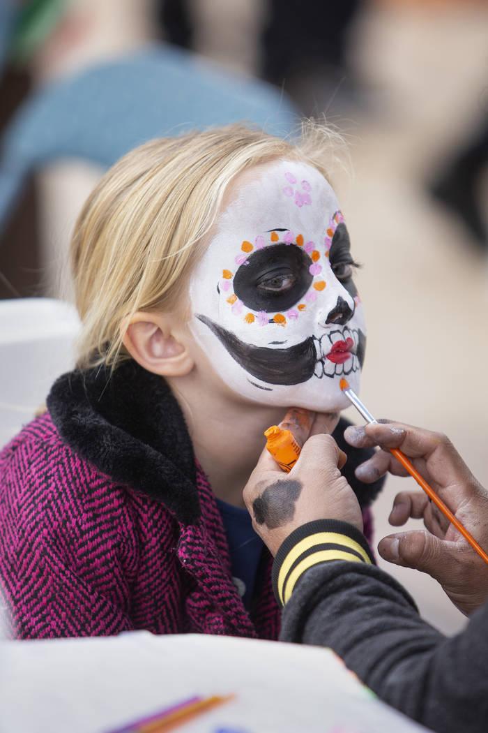 Charlotte Bright, 5, of Las Vegas, has her face painted as a sugar skull at the Las Vegas Tamal ...