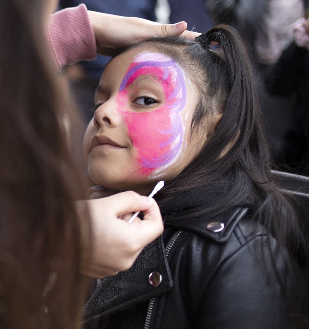 Violet Hernandez, 5, has a butterfly mask painted on her face at the Las Vegas Tamale & Mar ...