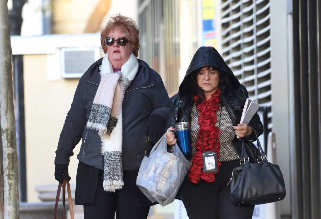Pedestrians are bundled up as they walk along Lewis Avenue in cold weather on Wednesday, Nov. 2 ...