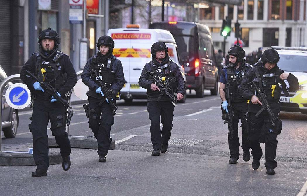 Police on Cannon Street in London near the scene of an incident on London Bridge in central Lon ...