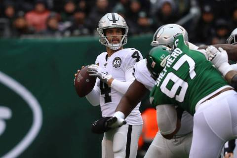 Oakland Raiders quarterback Derek Carr (4) looks for an open receiver to throw to as New York J ...