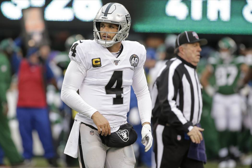 Oakland Raiders quarterback Derek Carr reacts during the second half of an NFL football game ag ...