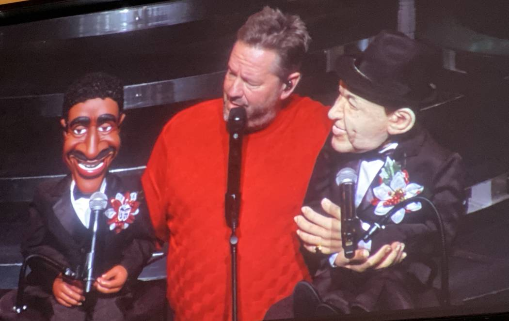 """Terry Fator is shown with his Sammy Davis Jr. and Frank Sinatra figures during """"A Very Terrry C ..."""