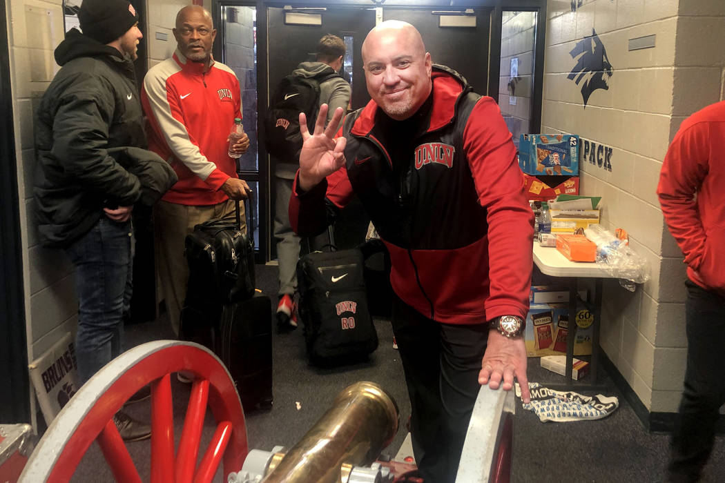 UNLV football head coach Tony Sanchez smiles with the Fremont Cannon after UNLV beat UNR 33-30 ...