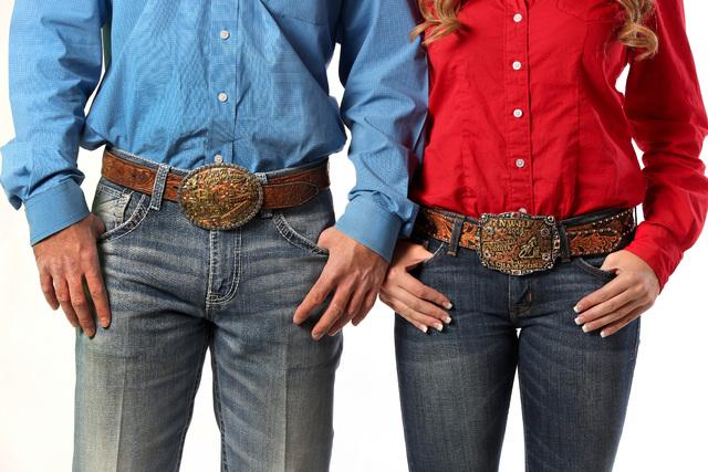Seniors Jordan Siminoe and Kendra Cates of the UNLV rodeo team wear their rodeo belt buckles, F ...