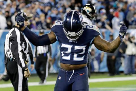 Tennessee Titans running back Derrick Henry celebrates after scoring a touchdown on a 74-yard r ...