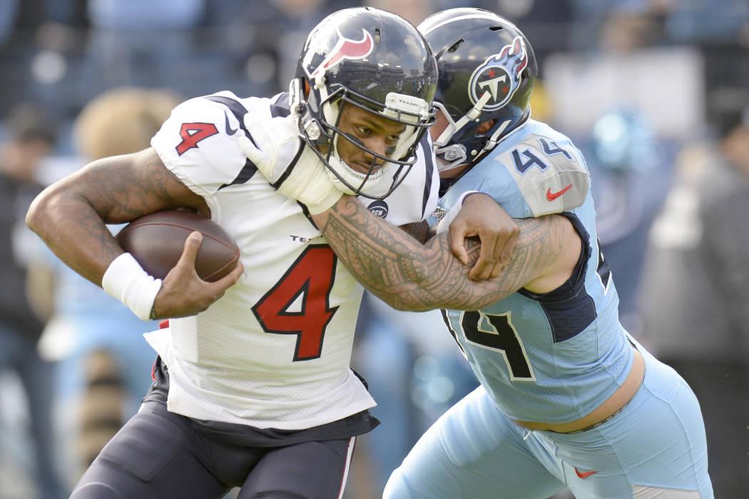 Houston Texans quarterback Deshaun Watson (4) is stopped by Tennessee Titans outside linebacker ...