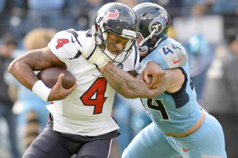 Houston Texans quarterback Deshaun Watson (4) is stopped by Tennessee Titans outside linebacker ...