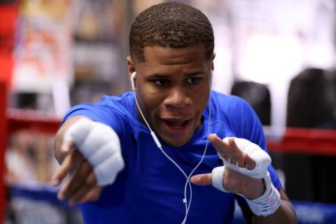 Boxer Devin Haney shadow boxes during a training camp workout at the Capetillo & TM Boxing Gym ...