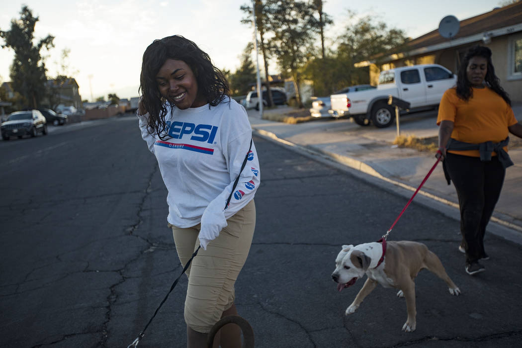 JennŽ Lewis, left, walks her dog with her mother Connie Lewis near their home in Las Vega ...