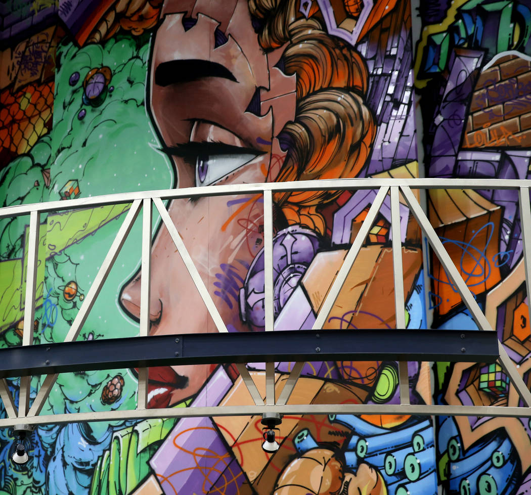 Murals in progress at Fashion Outlets of Las Vegas in Primm as the outlet mall is rebranded to ...
