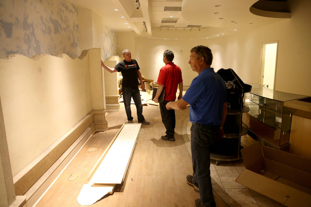 Vic Gibson, right, and Rick Gibson, center, of Dream Themes talk to project manager Darrell Reh ...