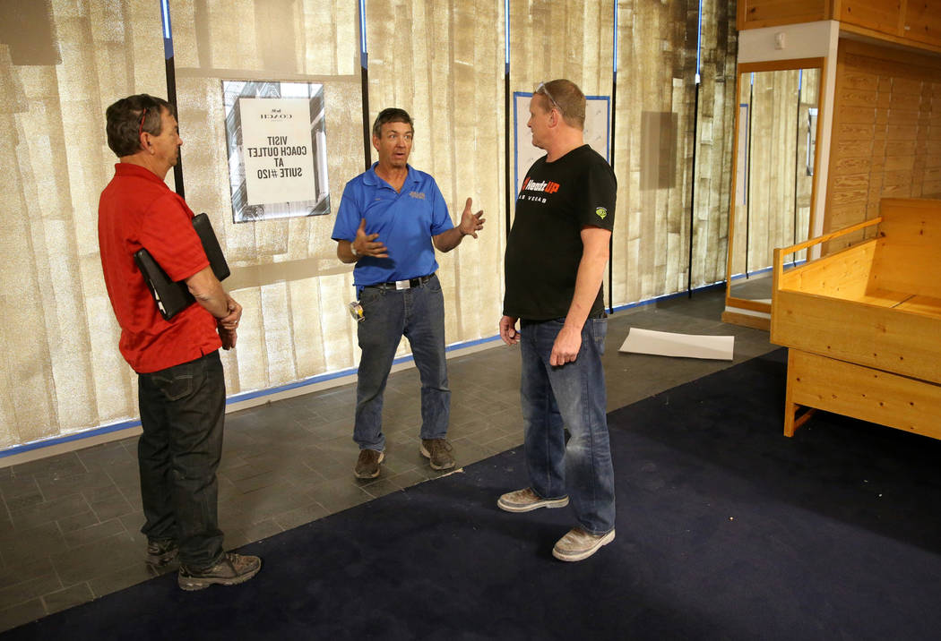 Rick Gibson, left, and Vic Gibson, center, of Dream Themes talk to project manager Darrell Reha ...