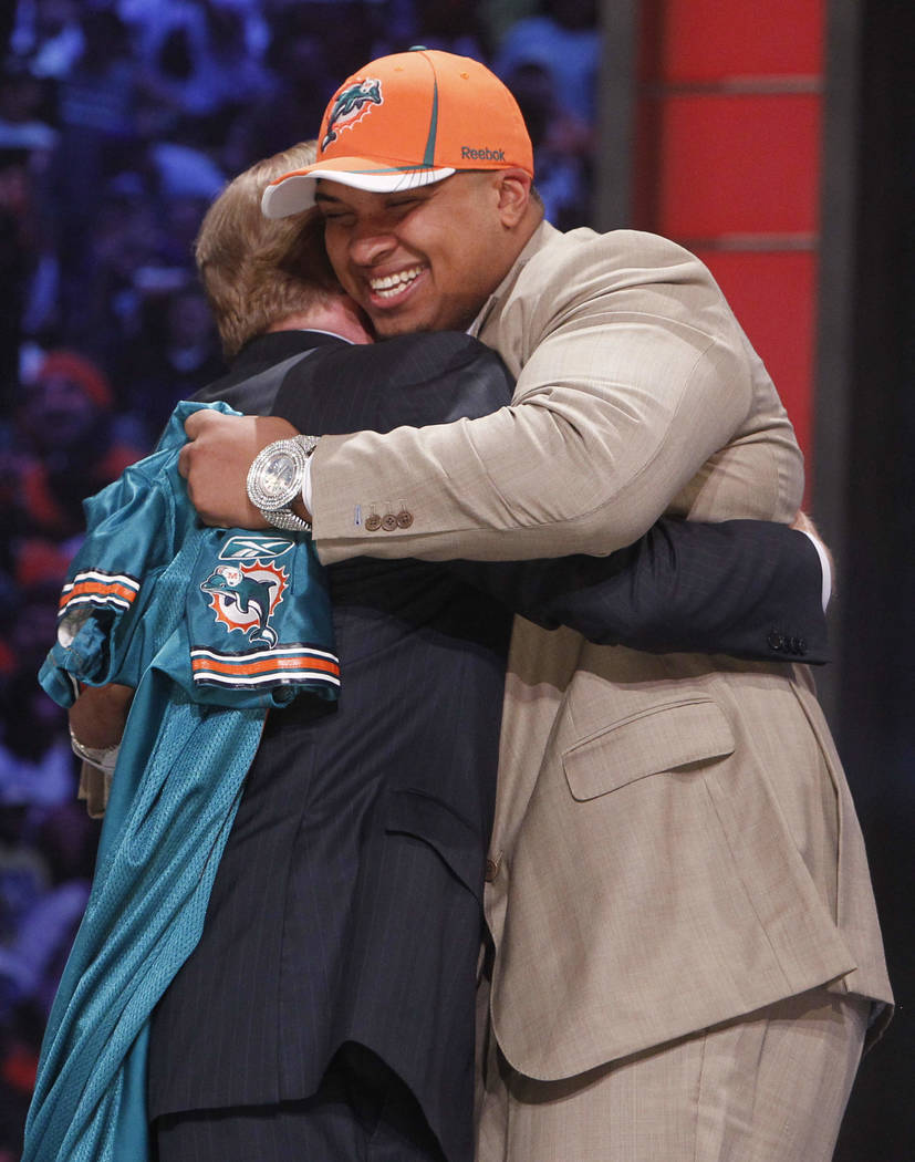 Florida offensive lineman Mike Pouncey hugs NFL commissioner Roger Goodell after he was selecte ...