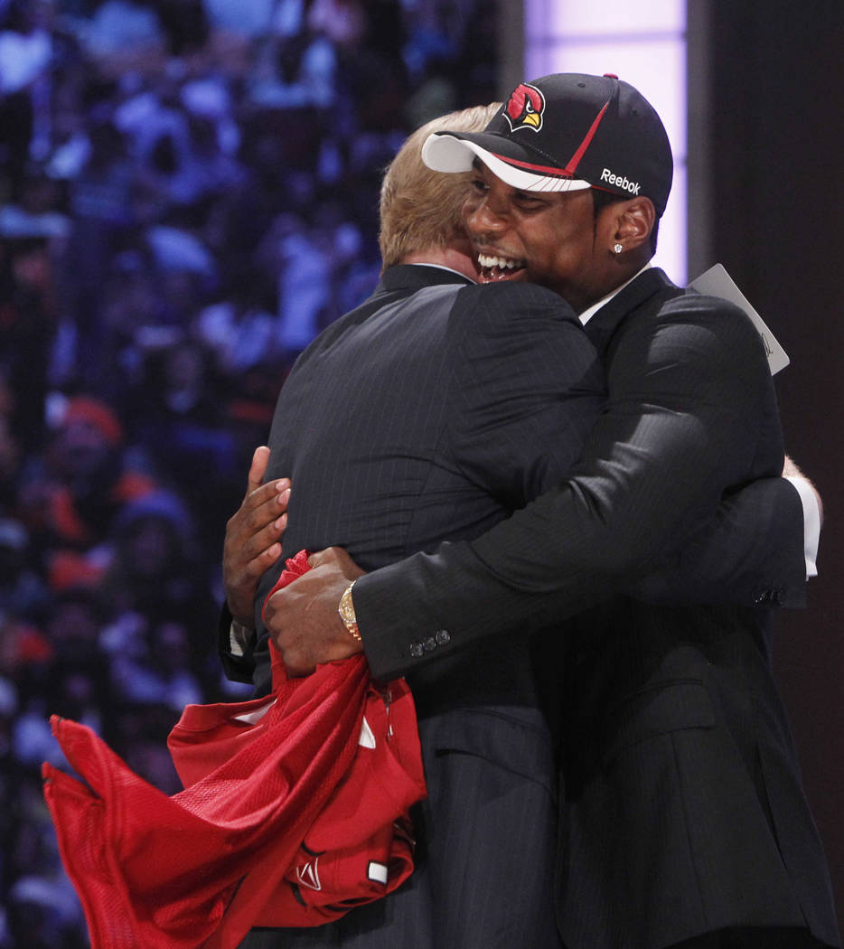 LSU cornerback Patrick Peterson, right, hugs NFL commissioner Roger Goodell after he was select ...