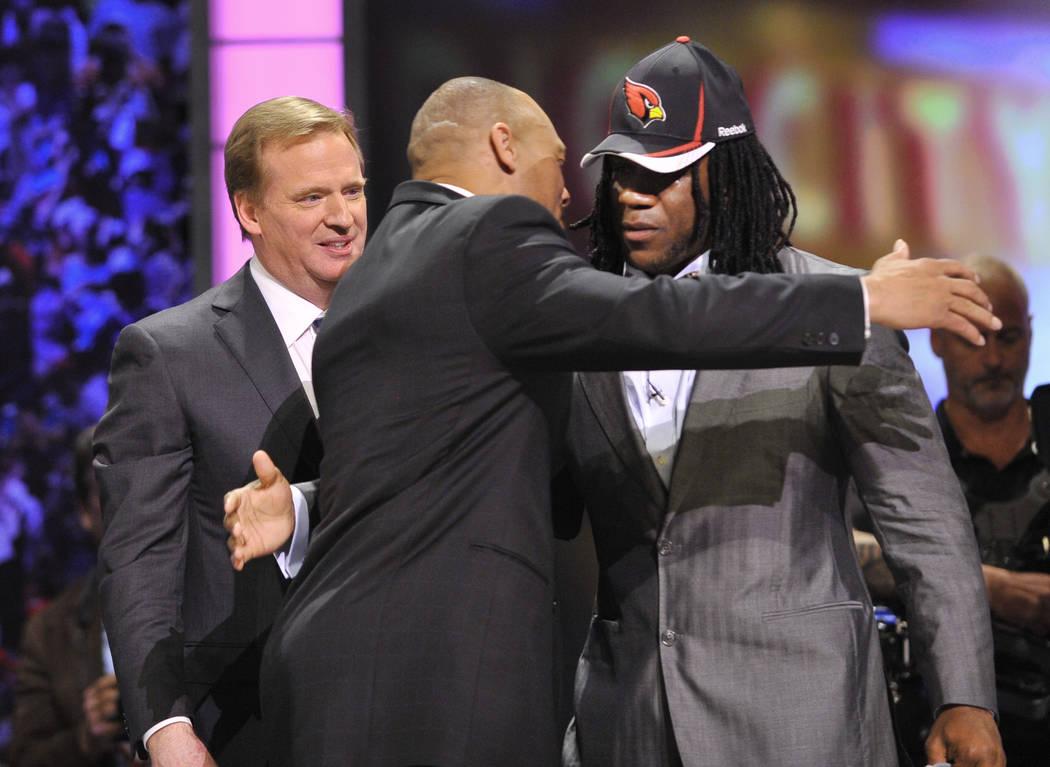 Virginia Tech running back Ryan Williams, right, hugs former defensive back Aeneas Williams as ...