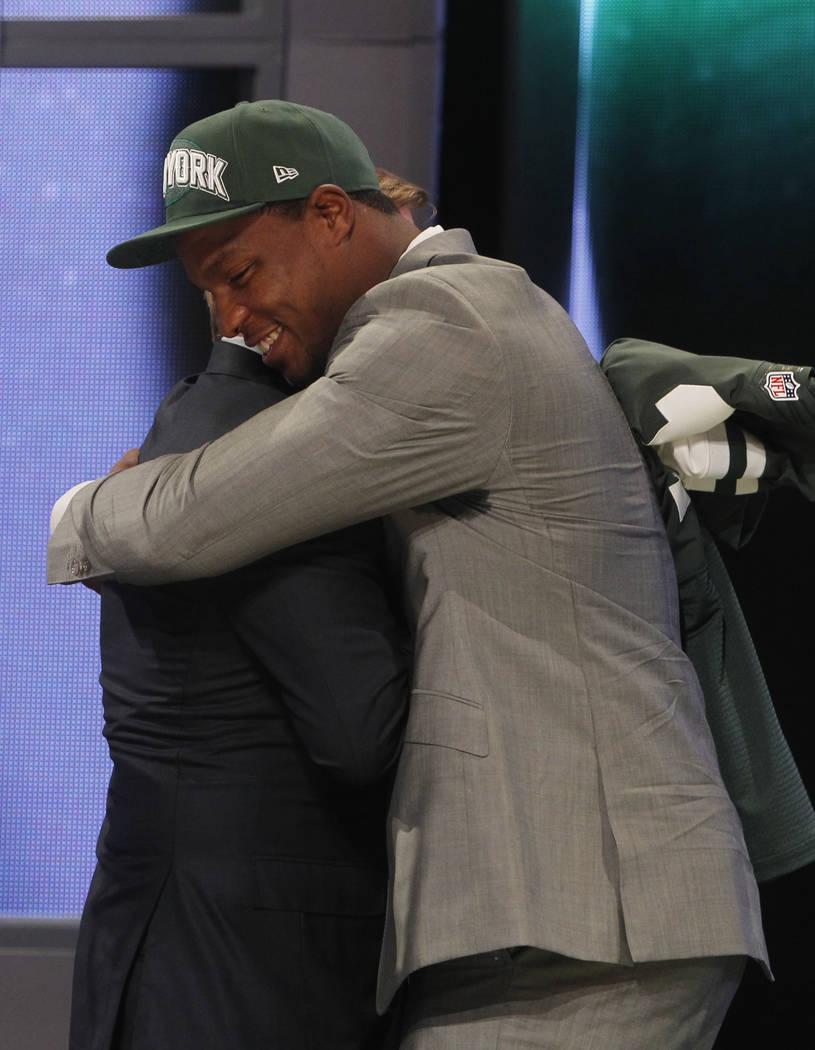 North Carolina defensive end Quinton Coples, right, hugs NFL Commissioner Roger Goodell after b ...