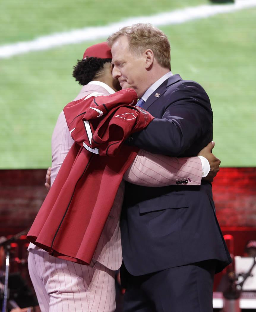 Oklahoma quarterback Kyler Murray embraces NFL Commissioner Roger Goodell after the Arizona Car ...