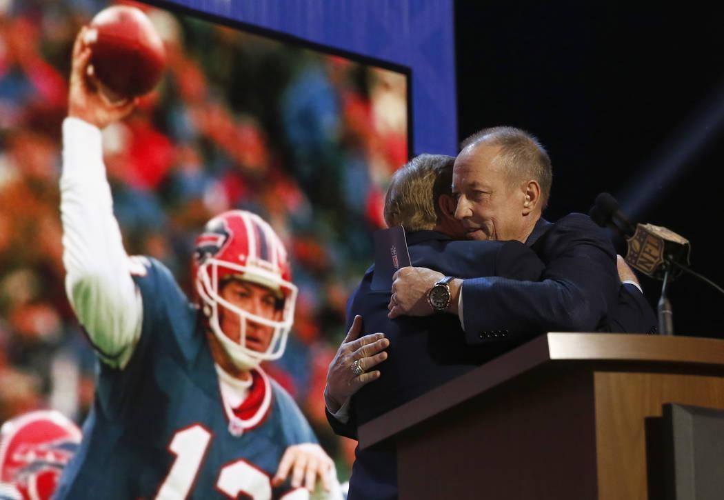 NFL Hall of Famer and Buffalo Bill Quarterback Jim Kelly hugs NFL commissioner Roger Goodell be ...