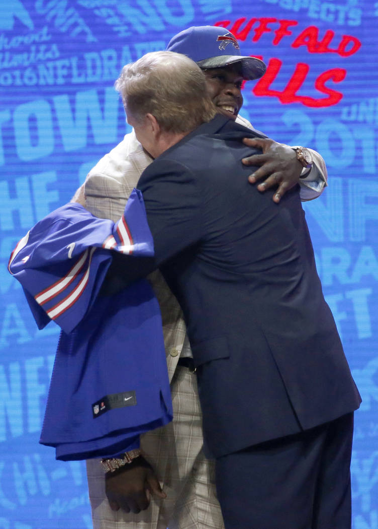 Clemsons Shaq Lawson embraces with NFL commissioner Roger Goodell after being selected by the B ...