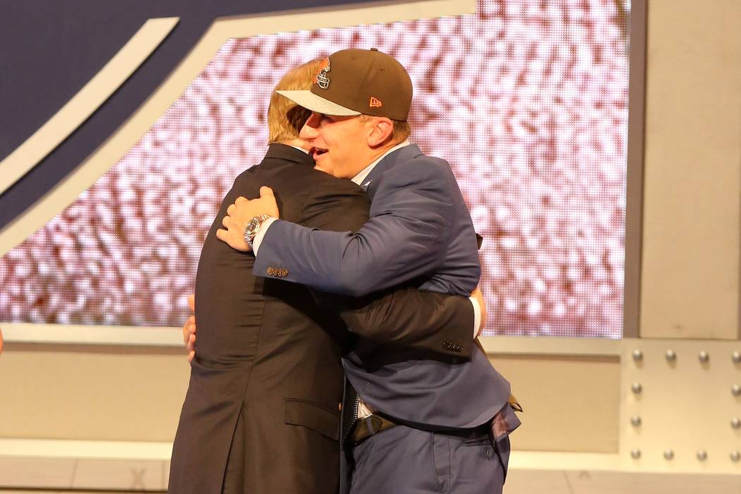 Johnny Manziel hugs NFL Commissioner Roger Goodell after being selected by the Cleveland Browns ...