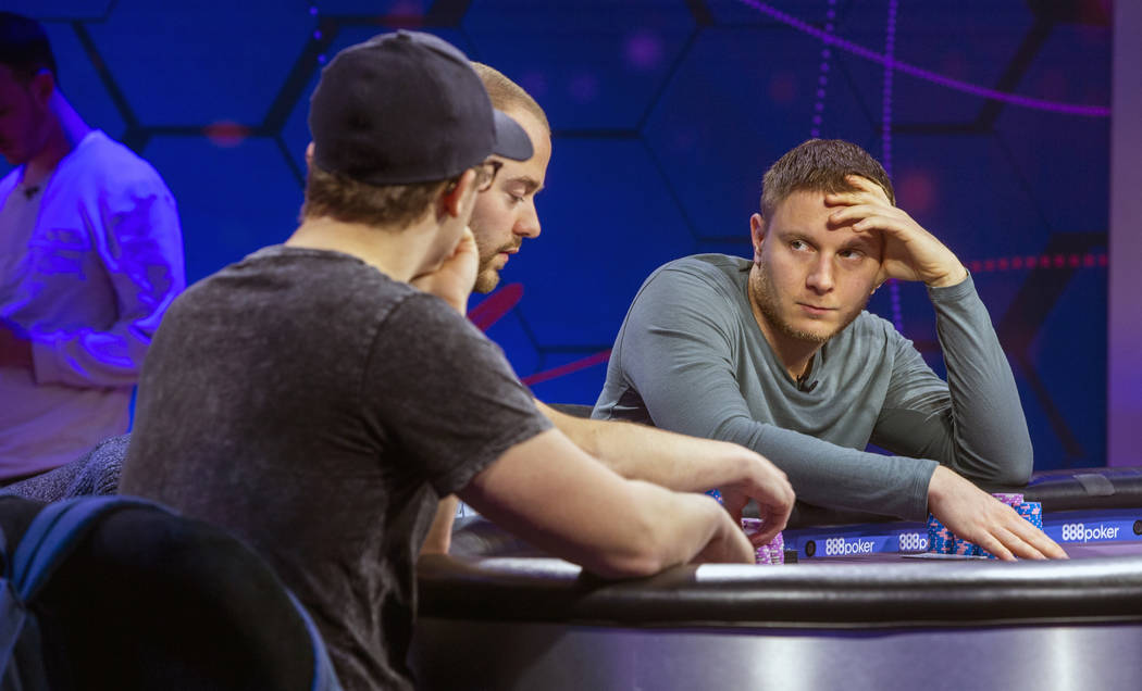 Kahle Burns, left, Sean Winter and Sam Soverel play on the main table during the 2019 Poker Mas ...