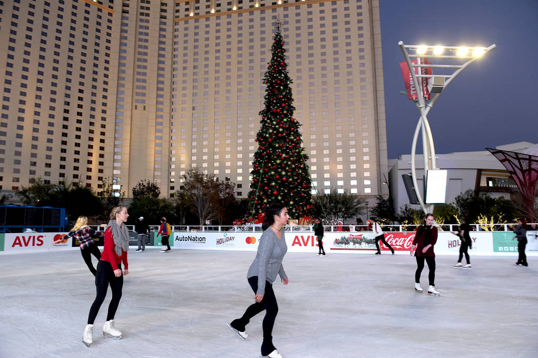 Skaters enjoy the ice rink set up in Toshiba Plaza during The Park's first-ever tree-lighting ...