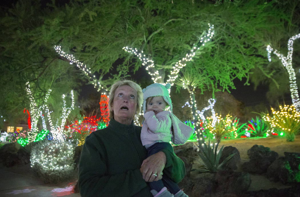 Cheryl Frazier, left, holds her granddaughter McKenna Dillon, 1, as they walk through Ethel M C ...