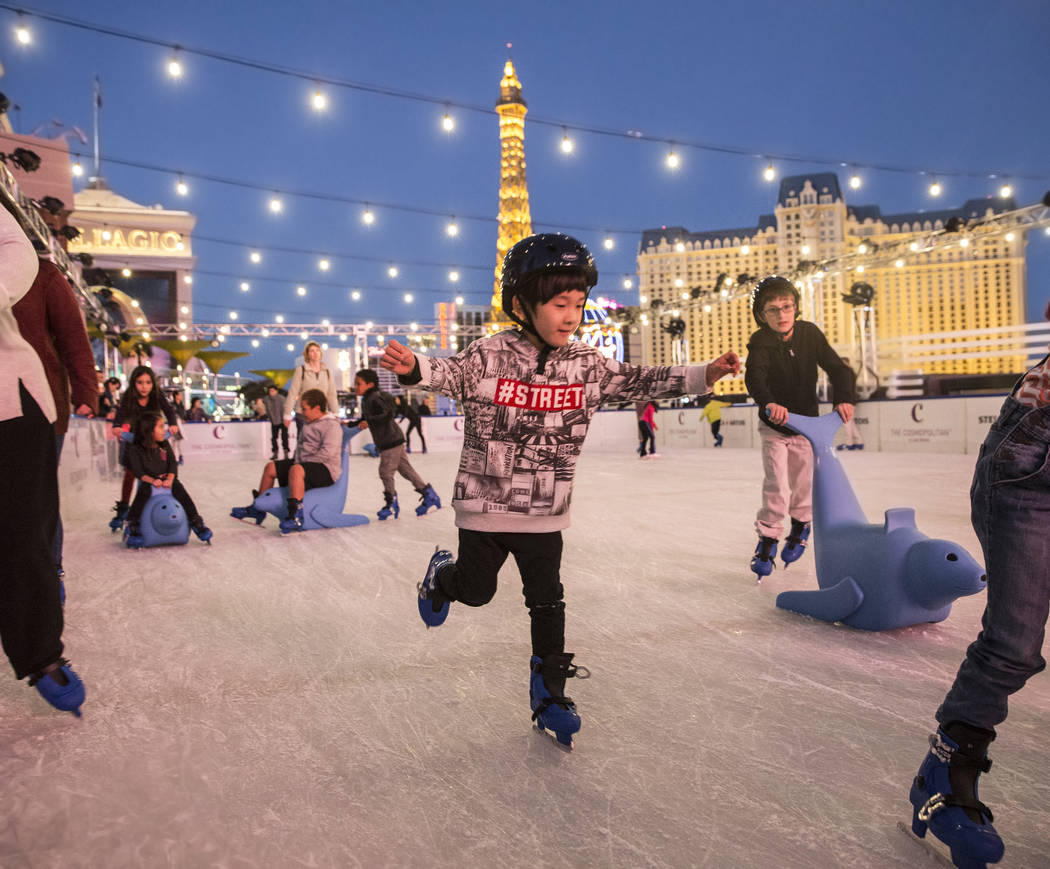 Skaters enjoy the last moments of light at dusk at the Cosmopolitan of Las Vegas Ice Rink on Mo ...