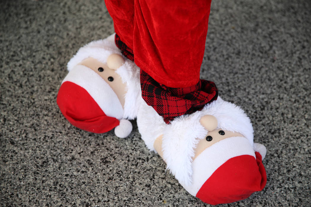 A runner wears Santa Claus themed slippers for the 14th annual Las Vegas Great Santa Run in Las ...