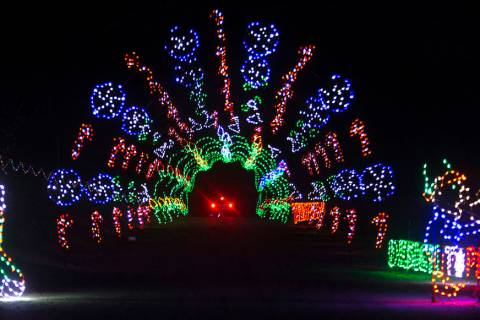 Vehicles drive through Glittering Lights on Sunday, Nov. 10, 2019, at Las Vegas Motor Speedway ...