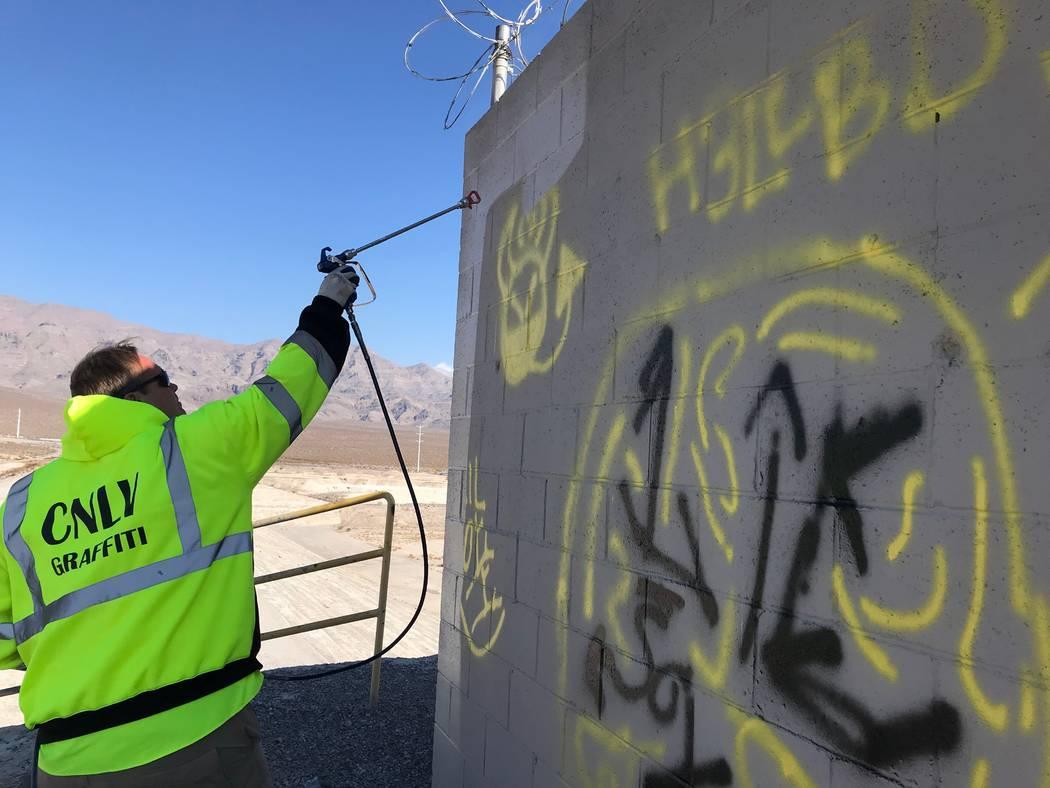 Graffiti Crew Leader Scott Nichols sprays over graffiti. (Alex Chhith/Las Vegas Review-Journal)