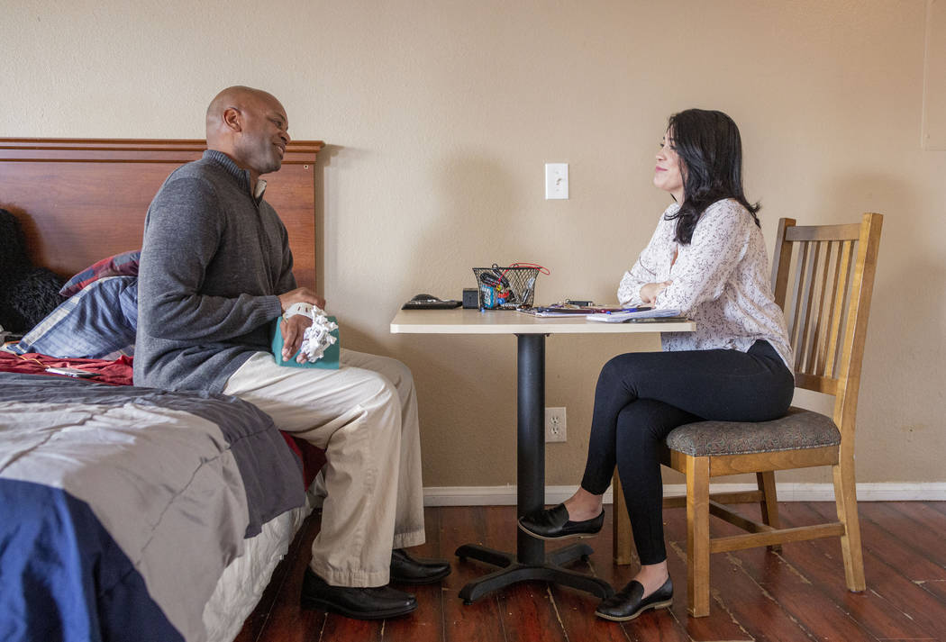Jeffrey Fikes, left, and Health Plan of Nevada health coach Leticia Beltran meet at Fikes' supp ...