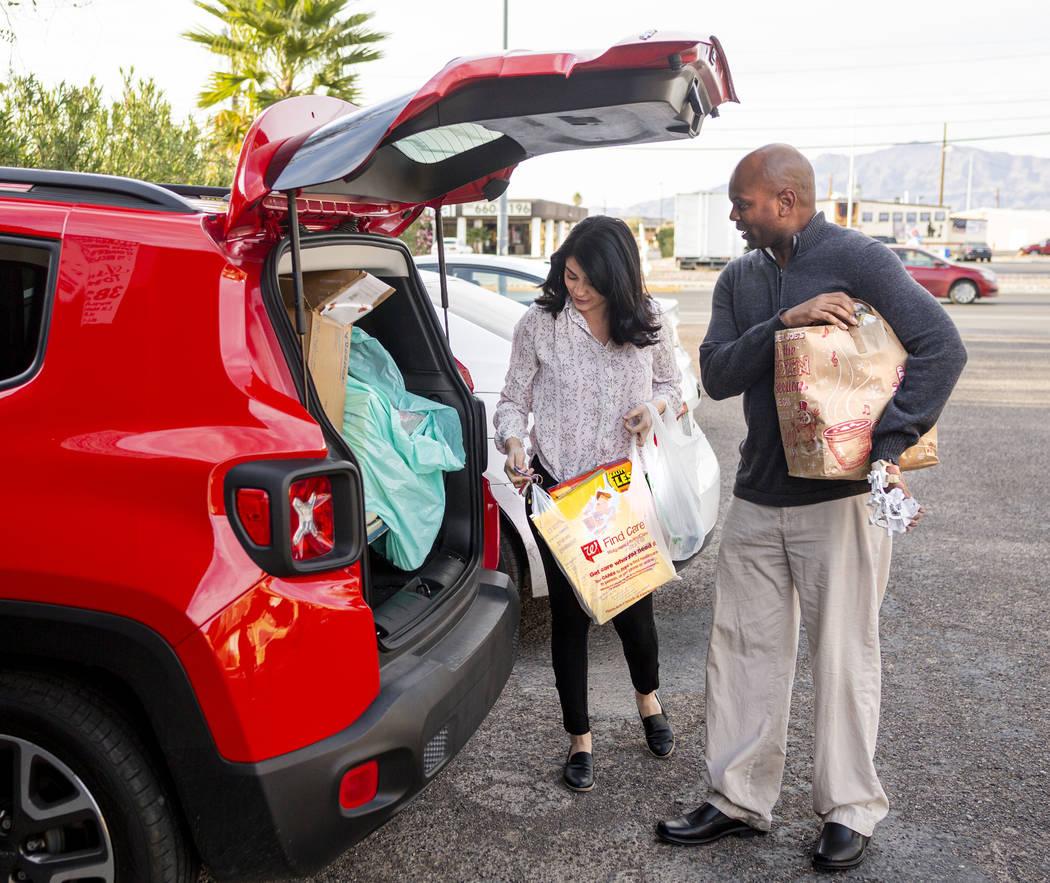 Health Plan of Nevada health coach Leticia Beltran, left, and Medicaid member Jeffrey Fikes, pi ...