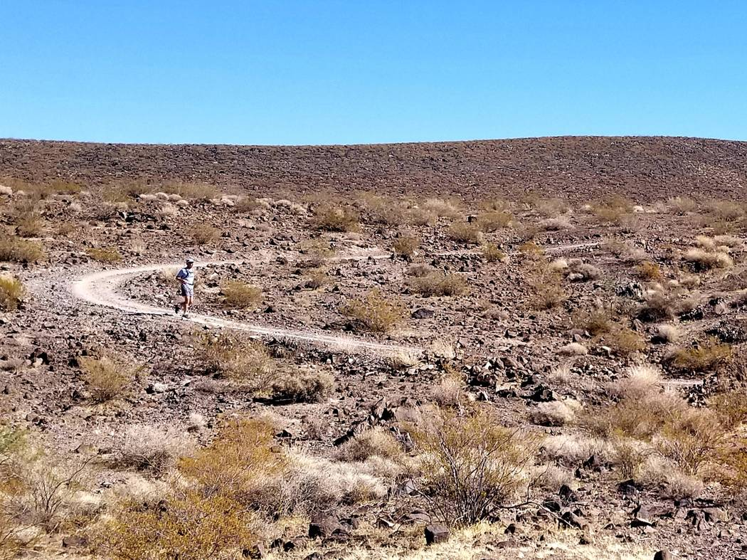 Runners find solitude and little traffic in the outback of Sloan Canyon National Conservation A ...