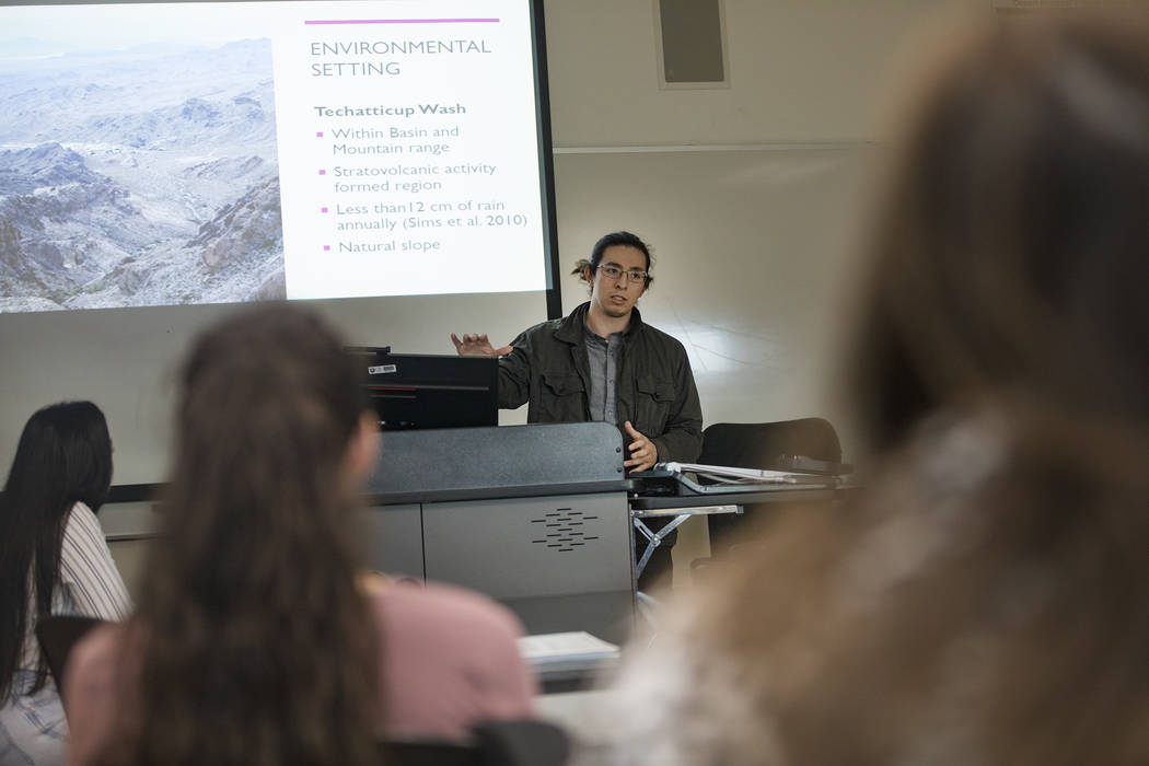Juan Garcia-Hernandez delivers a presentation in an environmental management class at the Colle ...