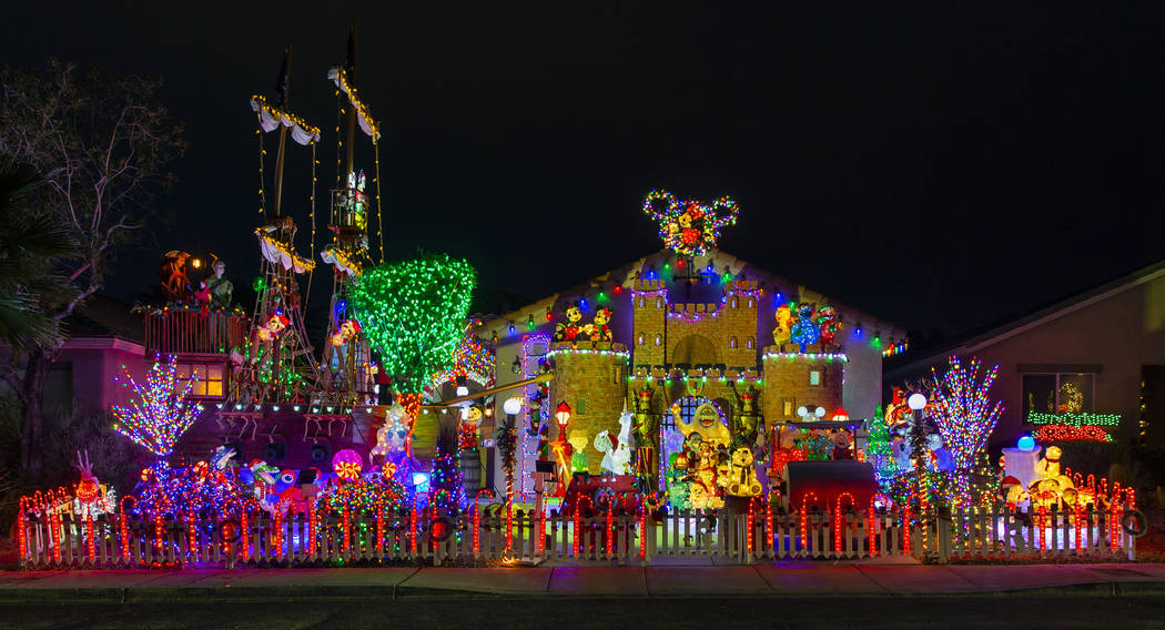 Thousands of holiday lights in the yard of Maria Acosta and Juan Torres which will be featured ...