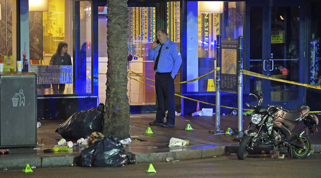 A woman looks out from inside a McDonald's fast food restaurant as New Orleans police investiga ...