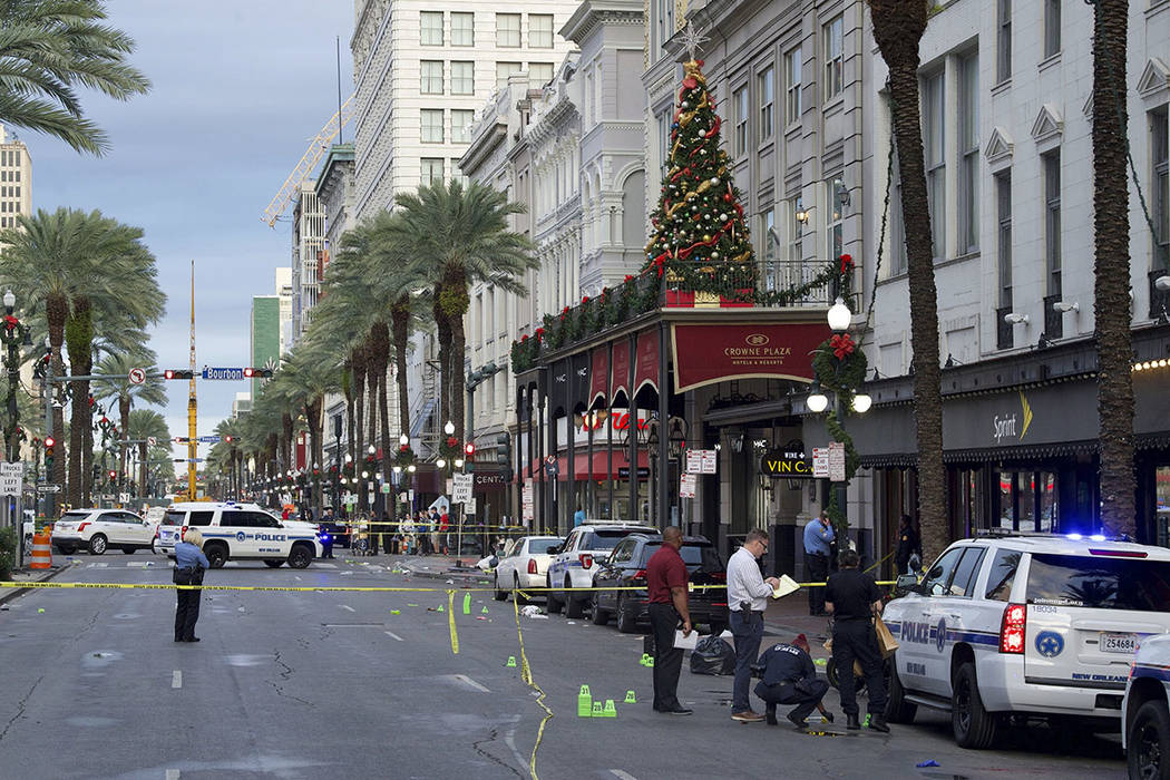 New Orleans police investigate the scene of a shooting Sunday, Dec. 1, 2019, on the edge of the ...