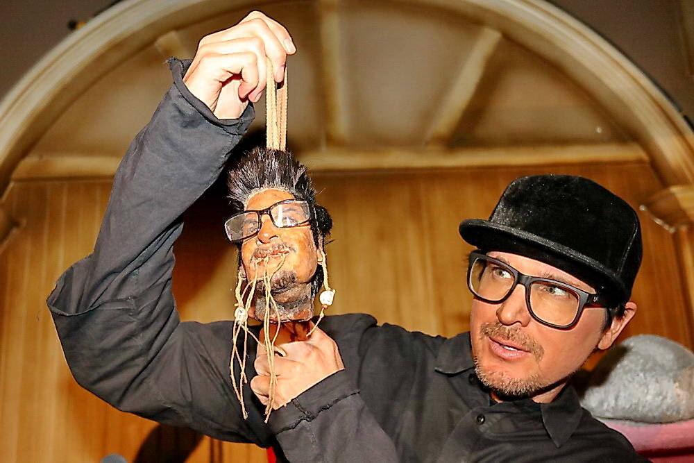 """Zak Bagans is shown with his shrunken head during a taping of """"Ghost Adventures"""" at The Golden ..."""